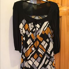 Geometric Multi-Color Dress This Geometric Multi-Colored Dress size 10 or Medium by Janette with colors gold, black and white captures any audience man or woman. It has been gently worn but holds up well. Janette Dresses Long Sleeve