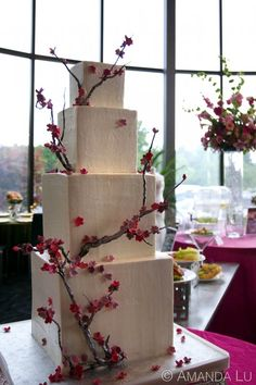 Delicate fondant Japanese Cherry Blossoms pair nicely with the clean modern lines of the cake   Photo Courtesy of Amanda Lu
