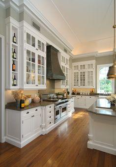 Virginia country house. Kitchen. Lancome limestone counters. Zinc vent hood. Franck & Lohsen, Architects.