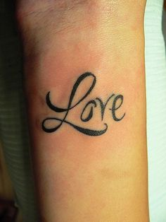 Love tattoo on wrist - a cute reminder to keep a positive outlook on life :)