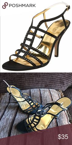 Nine West 'Proeze' Black satin evening shoe sandal Gorgeous and versatile sandal by nine W. Features gold insole and beautiful yet simple detailing. Approximately 3 1/2 inch heel. Size 8N (narrow) worn one time for a function. Heel tips are in excellent condition shows very little to no wear Nine West Shoes Sandals