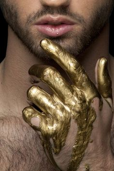 Gold painted hand
