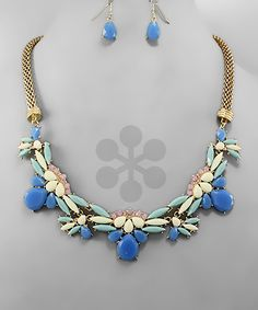 Blue/cream statement neck, one of our favorites!