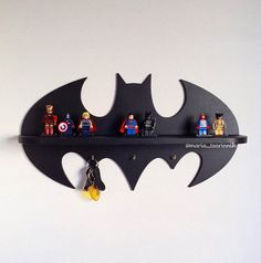 Shelf Batman (17,7 in x 9,5 in)   DIMENSIONS: height - 24 сm (9,5 inches) width - 45 сm (17,7 inches) + 3 hooks  Ideal for children or fans of comic book characters. You can hang it on the wall for example. It also makes a beautiful gift.  color black   # Shelf is sold without a LEGO #