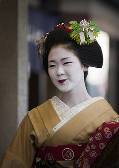 Maiko Ayano from Pontocho at the front of Minamiza theate, December 2010