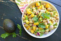 Tropical Chickpea Salad With Chickpeas, Purple Onion, Mango, Avocado, Chopped Cilantro, Lemon Juice, Olive Oil, Ground Cumin, Chili Powder, Salt