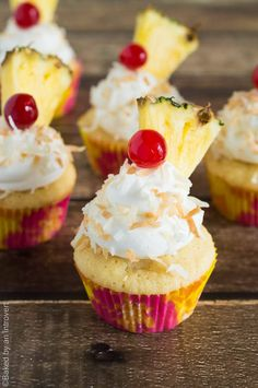 Pina Colada Cupcakes - These moist pineapple cupcakes with coconut frosting will make you feel like you are on a tropical island.