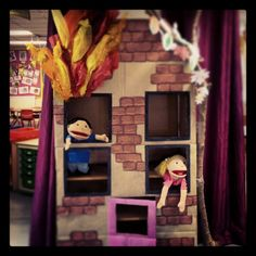 To go with our Fire station role play, the house has been created from a cabinet. Poor puppets need some help!