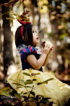 little girl dressing up as snow white
