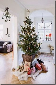 """perfect size tree in wicker with a """"hide"""" tree skirt"""