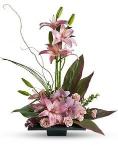 Imagination Blooms with Cymbidium Orchids. Perfect centerpiece for a contemporary wedding. #Cymbidium Orchid  #Orchids  #http://growingorchids.biz/