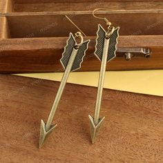 Antique bronze arrow earrings, inspired by the hunger games.