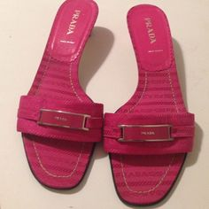 Canvas signature sandalssale 1 hr Authentic canvas slides with signature emblem in front. Signature shoe sleeve. Leather signature soles. Super cute. Only worn a few times. Good condition no flaws1 HR sale Prada Shoes Sandals