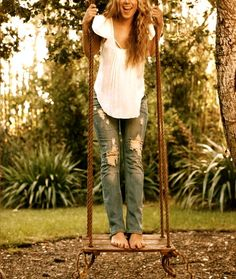 I want a wooden swing so bad! Maybe I could get my dad to put one on our tree! :)