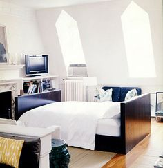 Small studio apartment. I find that the bed is the focal point is very interesting.