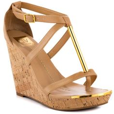 Shake what you got in the Tremor!  This stylish DV by Dolce Vita sandal brings you a chic nude upper with gold detail featured on the t-strap.  A 4 1/2 inch cork wedge, 1 inch platform and adjustable ankle strap complete the look. - HighOnShoes.com
