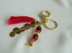 Items similar to Key Chain / Bag Charm - Red and gold with ottoman turkish signature coin charms, dragonfly, tassel and red glass beads on Etsy Bubble Envelopes, Organza Gift Bags, Red Glass, Key Chain, Tassels, Glass Beads, Ottoman, Charms, Personalized Items