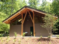 Back side of the bath house #bathhouse #wood #woodcolumns #windows #nature #camping