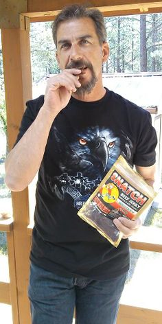 Q C Dave enjoying some Whisky Row SNATCH beef jerky!