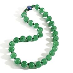 A MAGNIFICENT AND HISTORIC IMPERIAL JADEITE BEAD NECKLACE, QING DYNASTY The single-strand composed of 30 jadeite beads of uniform size, measuring approximately 13.44 to 13.32 mm., the translucent stones of brilliant emerald green color, some suffused with areas of paler hue, the silver clasp of later date centering a round star sapphire flanked by 2 translucent pear-shaped emerald cabochons, length 19¾ inches.