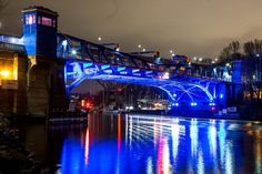 The Fremont Bridge glows during a preview of the $212,000 Bridge Lights project Wednesday. The light display, installed under the bridge and on the bridge sidewalks, will be permanently lighted Thursday. (Courtney Pedroza / The Seattle Times)