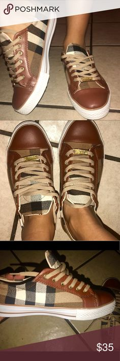 Burberry sneakers Classy plaid low top sneakers with a brown leather top and gold Burberry charm. Never worn (these shoes are not  The real Burberry brand) Burberry Shoes Sneakers