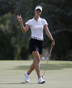 Michelle Wie of the U.S. waves after making a birdie putt on the fifth hole during the second round of the Kraft Nabisco Championship LPGA golf tournament in Rancho Mirage, California, April 5, 2013. REUTERS/Danny Moloshok (UNITED STATES - Tags: SPORT GOLF)