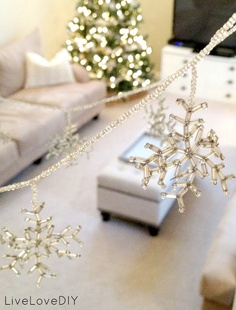 DIY beaded snowflake garland! For only $5 worth of wire & beads, you can add a little bling to any room this Christmas!