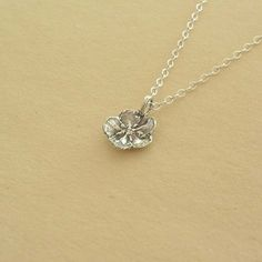 Totally loving this new jewelry shop I found on Etsy...a taste of spring!  Forget me not flower charm necklace solid by stratussilver on Etsy.