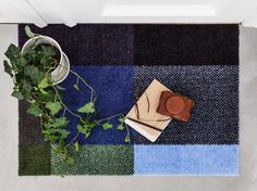 Mix Forest doormat is inspired by the different hues of the green forest and blue sky.
