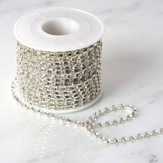 Spruce your Favors and Crafts Up with efavormart's Sparkling Line of Decorative Rhinestone Diamonds. Shop for Diamond Trim Rolls to decorate Centerpieces, Dresses, Vases, and DIY Projects. Ribbon Decorations, Diy Decoration, Design Your Own Jewelry, Wooden Lanterns, Glass Centerpieces, Diy Ribbon, Diamond Sizes, Silver Diamonds, Event Decor