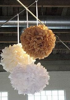 tissue paper hanging balls for part of photo booth backdrop on sides.