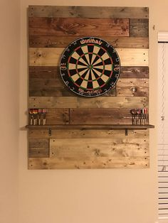 This is a custom made dartboard. Dimensions are 3 ft wide by ft long. All wood can be custom stained and/ or painted. Wood& The post This is a custom made dartboard. Dimensions are 3 ft wide by ft long. All wo& appeared first on Rees Home Decor. Dart Board Backboard, Hanging A Dart Board, Game Room Basement, Basement Ideas, Teen Basement, Man Cave Basement, Playroom, Pool Table Room, Deco Nature