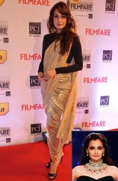 You can choose a bold, sheer, shimmery dhoti-saree like Dia. - bollywoodshaadis.com