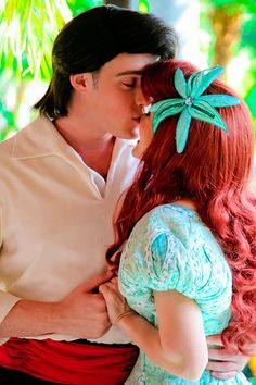 Ariel and Prince Eric<3 #disneyland :)  sorry but cartoon Eric was way hotter than that.