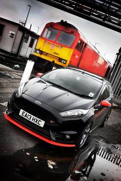 http://www.fiestastoc.com/forums/user/10411-rob001/ Great pic black fiesta st red trim