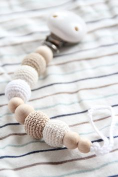 NEW Natural baby pacifier clip / Dummy holder / Beads are safe for teething !!!  This pacifier clip is made from natural materials - high quality wooden beads, wooden clip, crochet beads and crochet cord. Beads are light, perfect for teething. While Your baby will chew these beads, his/her gums will be massaged.  This is not just a pacifier clip but also a nice baby teething toy! Beads are safe for teething. Beads are made from beech wooden beads and crochet cord is soft. Length of the…