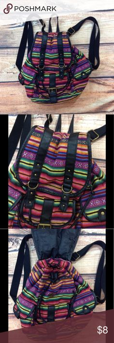Baja Print Backpack Joe Boxer Baja Print Backpack. In very good used condition and super cute!  Has pockets on each side and on the front, all have velcro closures. This backpack is medium size with adjustable straps. Measurements were taken laid flat and are approximate. Length - approximately 15 inches long. Width - 10 1/2 inches across. Joe Boxer Bags Backpacks