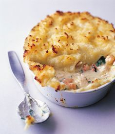 An easy fish pie recipe made with cod, tiger prawns and spinach with a creamy mashed potato topping.