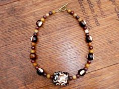 Ghana - Ethnic necklace in ocre colors with african style bone beads.