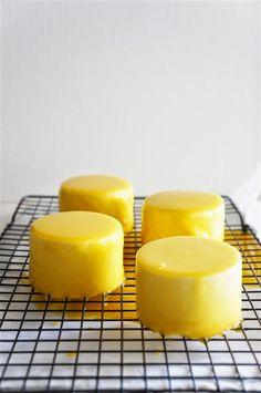 Mango glaze. Bring to boil mango puree, sugar, glucose and cream and,off heat, add the white chocolate and softened gelatin.Cool to room temperature. (Besides the glaze, this Mango Bliss entremet consists of: sponge cake, mango jelly, mango bavarian cream.)