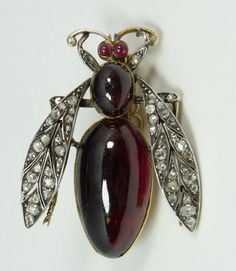 RUBY & DIAMOND BEE  18k yellow gold pin mounted with ruby jewels to body and diamonds wings. Holds large oval cabochon ruby.