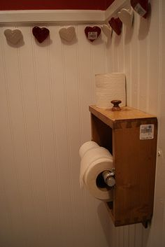 drawer repurposed into toilet paper holder