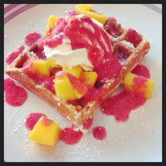 Belgian waffles with strawberry purée and fresh cut mango!!