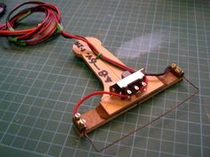 Handheld Hot Wire Foam Cutter by Ron Rees -- Homemade handheld hot wire foam cutter constructed from wire, wooden paddle handles, a switch, and a 4.8V NiCad battery pack. http://www.homemadetools.net/homemade-handheld-hot-wire-foam-cutter