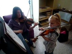 """[with] her violin teacher, Miss Sharon; Playing """"Lightly Row"""" duet from the """"Tune a Day"""" book. See more of young violinist #daughterA_from_RebeccaSigns"""