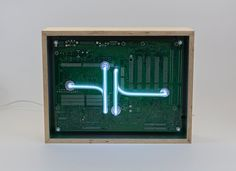 We create [dys]functional spectr-objects using recycled electronics and light. Machine Age, Silver Paint, Light Decorations, Wooden Frames, Recycling, Objects, Classy, Neon, Tube