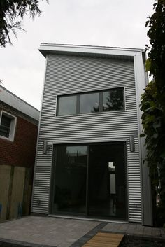 Mini house by architectural studio LineBox sits on Craven Road in Toronto, Canada (07)