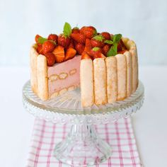 A charlotte is a French cake in which sponge fingers form the sides, concealing a set fruit mousse filling. You can add chopped strawberries to the filling if you want more texture and colour throughout.