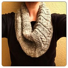 A simple cabled cowl with garter stitch ribbing. FREE